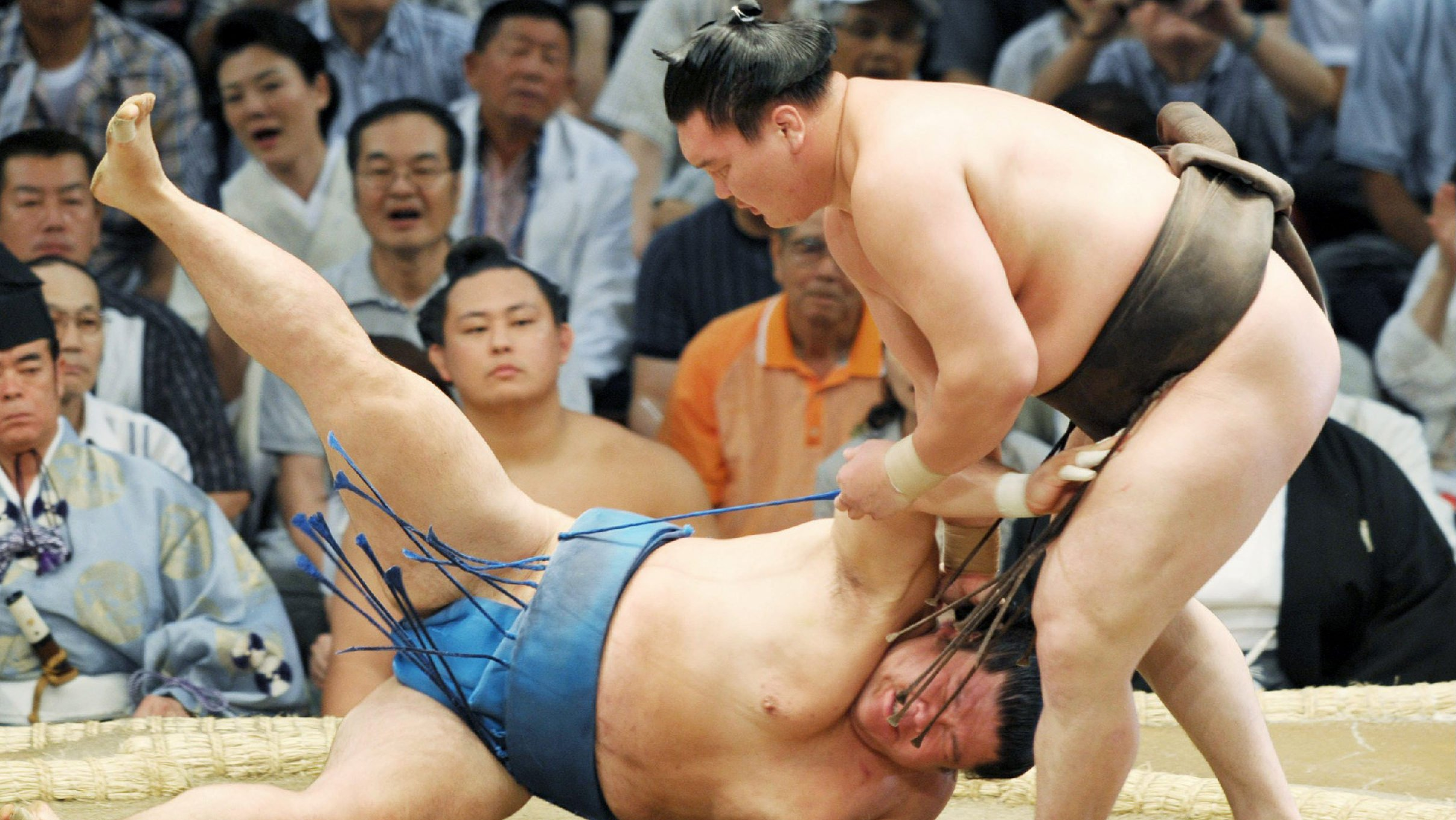 Why do sumo wrestlers compete half naked